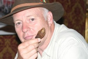 "Author Ron Franscell just before he drank a cocktail containing this mummified human toe, the quest of his father-and-son road book, ""The Sourtoe Cocktail Club."""