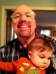 Kevin Sullivan enjoying a grandbaby before embarking