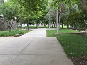 On April 17, 1974, Ted Bundy would lead Susan Rancourt down this sidewalk to the bridge that crosses the pond (the pond now filled in, and the bridge was located where the newer concrete is located), and as they stepped off the bridge, they angled their way to the left on a trail that lead to a deserted area by a railroad trestle where the killer had parked his car