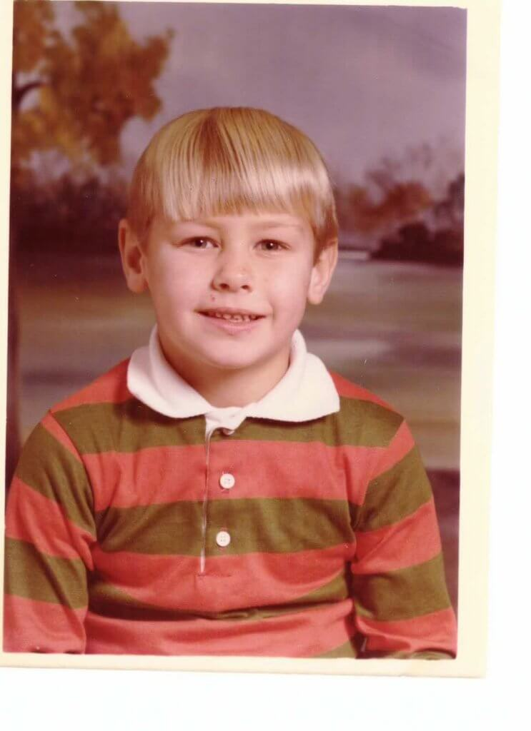 Howell's school photo wearing orange striped shirt, circa 1976.