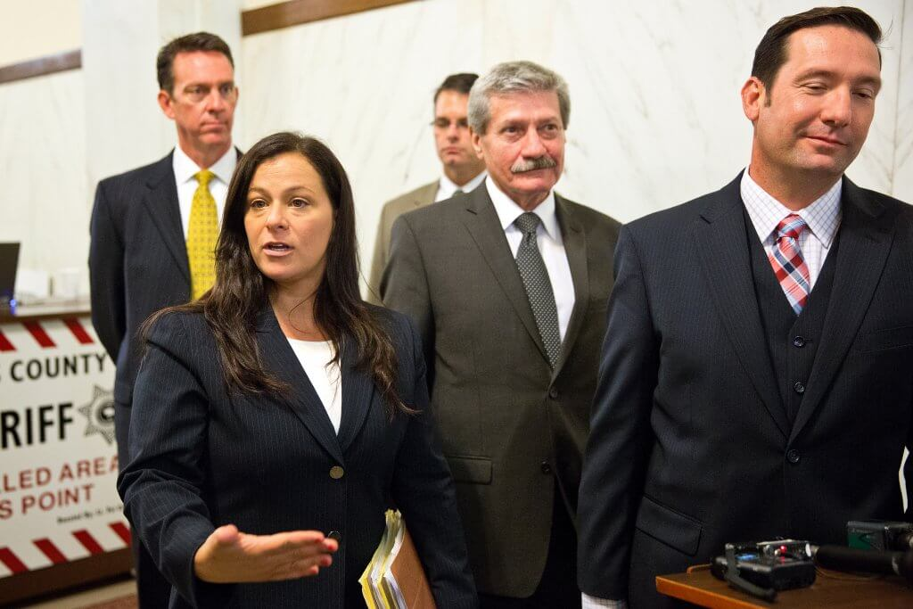 Defense attorneys Pat Dunn, from left, Alison Motta, Dan Stockmann, Robert Motta Sr. and Bob Motta II, speak to the media following Anthony Garcia's appearance in the Douglas County Courthouse for a preliminary hearing on Aug. 14, 2013. Ryan Soderlin/The World-Herald