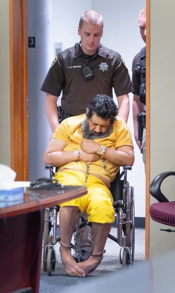 Douglas County Sheriff's deputies wheel a non-communicative Anthony Garcia into court for his death penalty sentencing hearing in Judge Gary Randall's courtroom June 13, 2018. Omaha World-Herald Photo