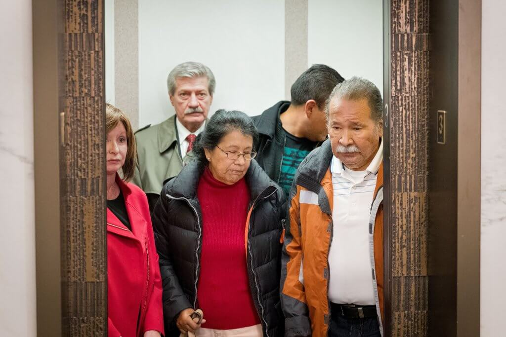 Estella Garcia and Frederick Garcia, center and right, parents of defendant Anthony Garcia, along with attorney Robert Motta Sr., background left, leave the courtroom after the jury was sent to deliberate. Garcia was charged with four counts of first-degree murder in the March 2008 deaths of Thomas Hunter, 11, and Shirlee Sherman, 57; and in the May 2013 deaths of Dr. Roger and Mary Brumback, both 65. Matt Miller/The World-Herald