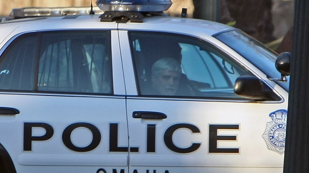 William J. Hunter, M.D. leaves in an Omaha Police car from his home at 303 N. 54th St. in Omaha, Nebraska March 13, 2008. His son and house cleaner were found dead inside his home. Jeff Bundy/The World-Herald