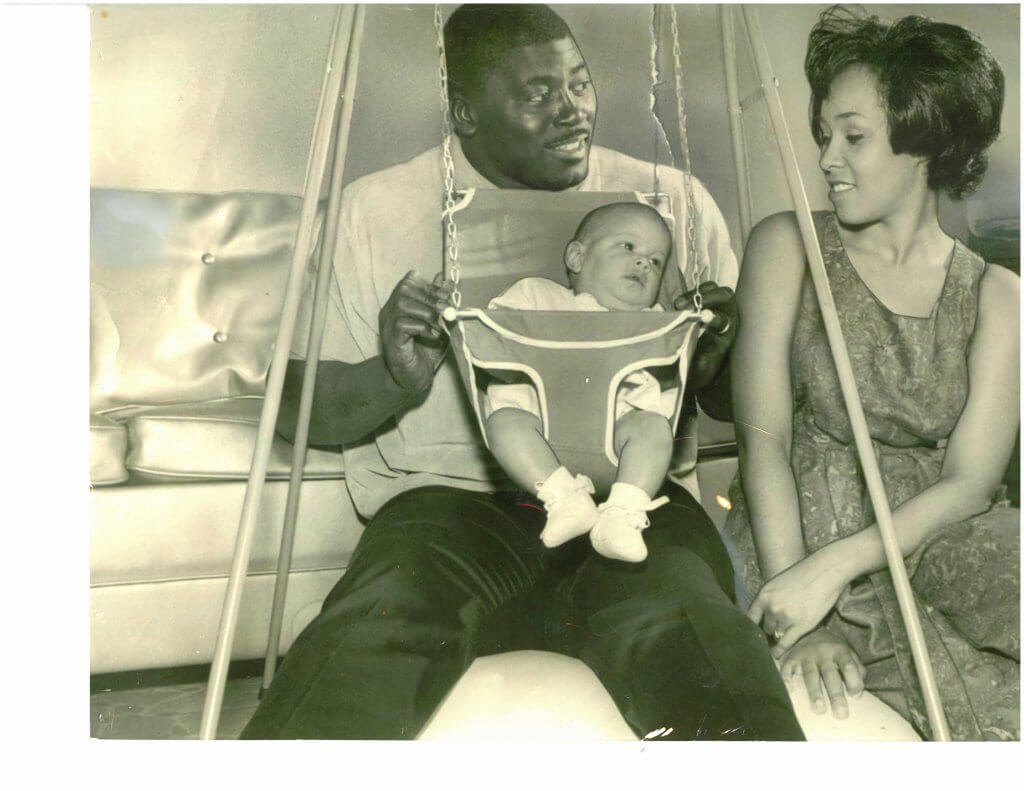Barbara and Earl Faison with their daughter, Monique, in the swing. This image appeared in the San Diego newspaper. From the collection of Monique Faison Ross.