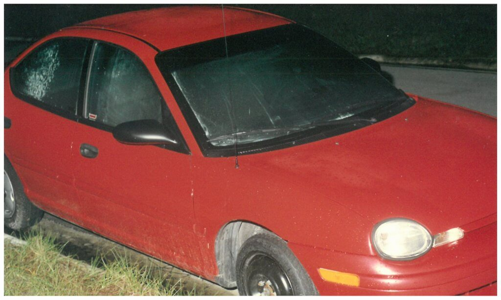 Monique's red Dodge Neon. Visible in the photo is the spare tire on the right front that Chris had changed during the kidnapping. Photo taken by the Jacksonville Police photographer.