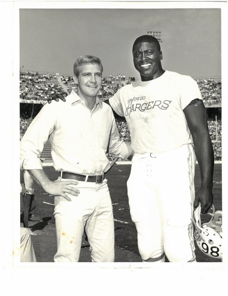 Earl appeared on several TV shows, including The Six Million Dollar Man. Here he poses with the show's star, Lee Majors. From the collection of Monique Faison Ross.