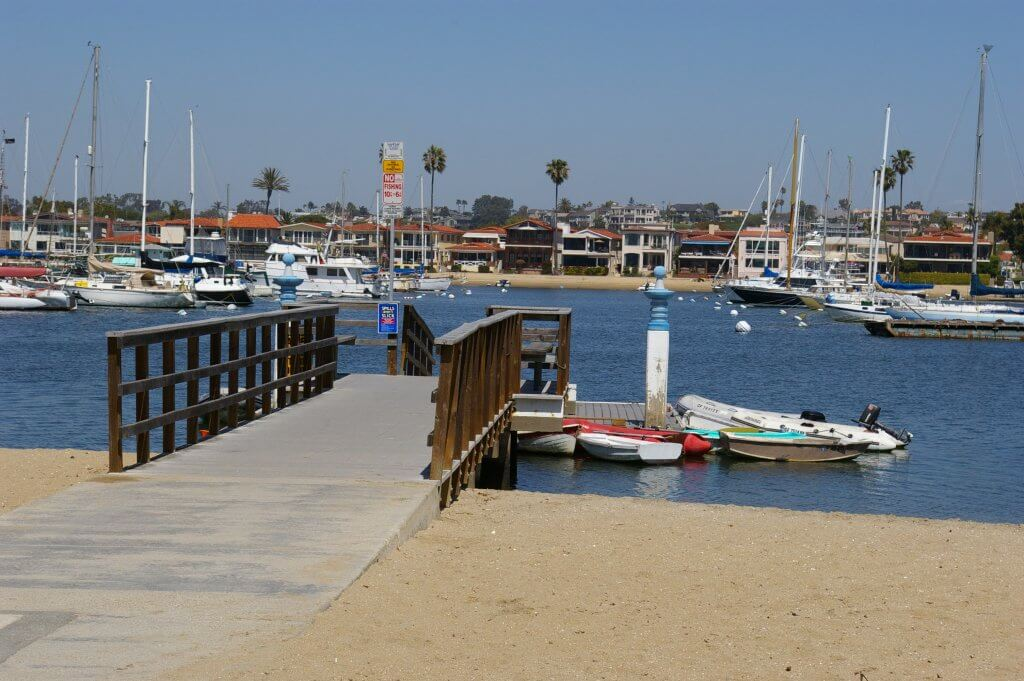 The Deleons claimed the sale of the Well Deserved was notarized near this 15th Street dock at the Newport harbor, after which the Hawkses drove off in their silver CRV. Photo by Caitlin Rother