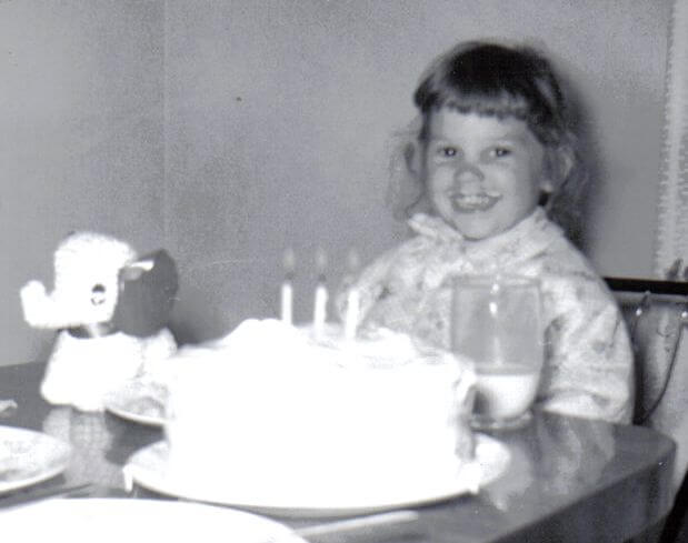 Jackie O'Neill celebrates her third birthday in Mentor, Ohio, in 1960. Photo by Jack O'Neill