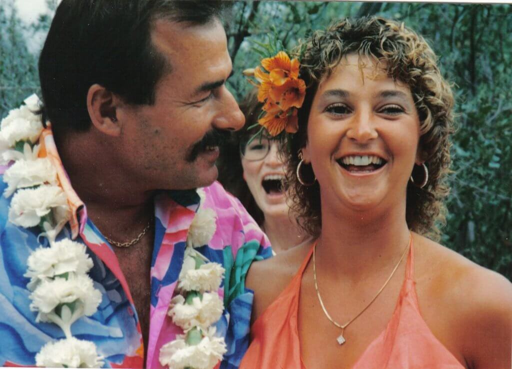 One hundred and fifty friends and family members attended Tom and Jackie's Hawaiian-themed wedding in July 1989, in the back yard of Tom's rustic, Western-style house in Prescott, Arizona. Photos by Jack O'Neill