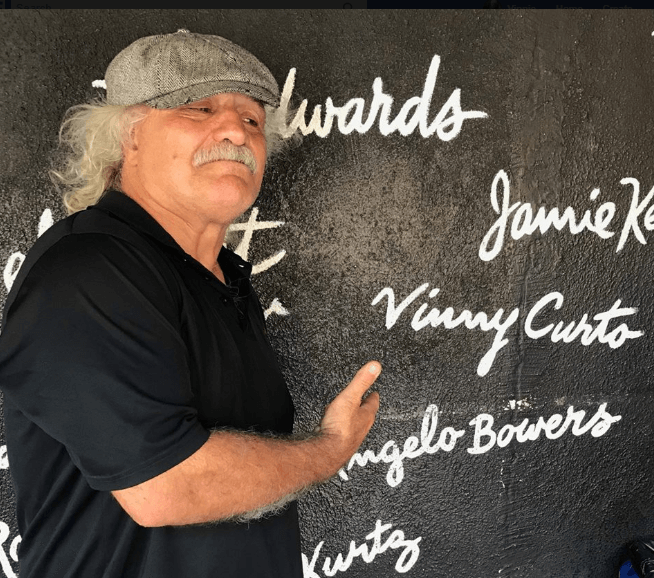 Vinnie showing off his name on Wall Comedy Store as Sam Kinneson